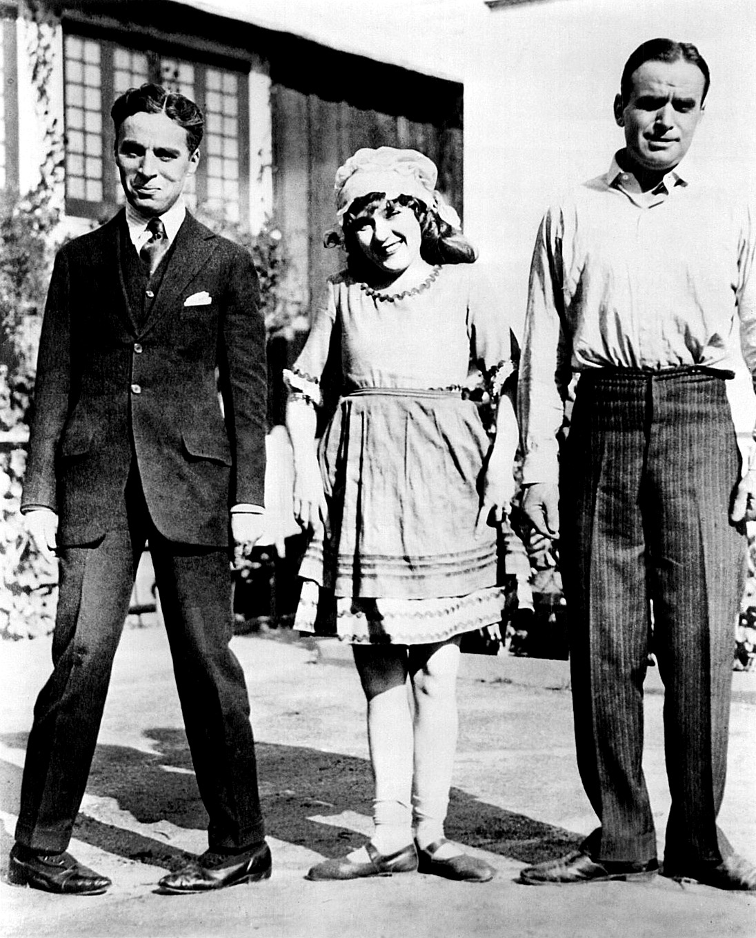 Best Mates: Doug and Charlie frame Mary Pickford.