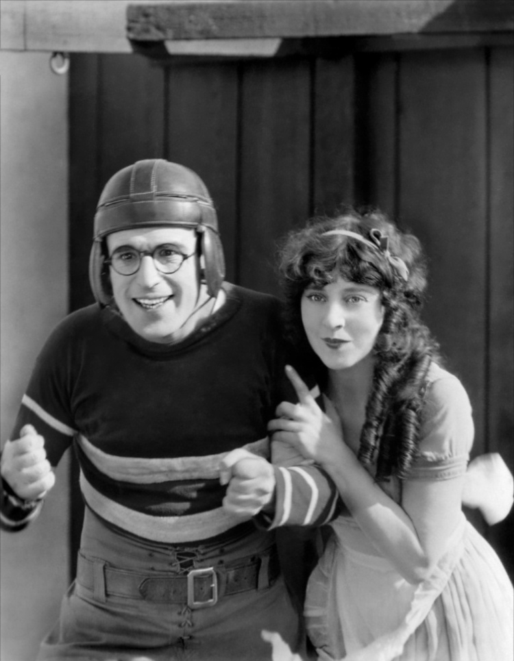 "Lloyd with his delightful leading lady Jobyna Ralson in ""The Freshman,"" 1925. A fabulous satire on college life."
