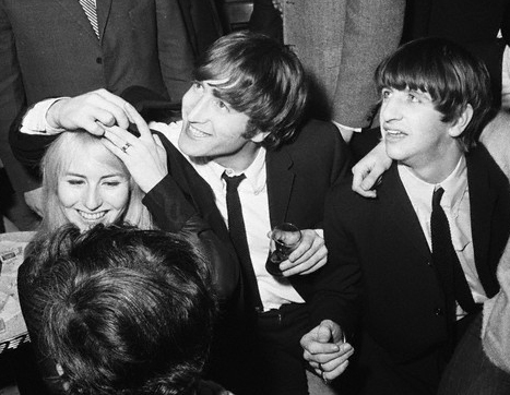 John at the Peppermint Lounge, 1964, with Ringo and wife Cynthia.